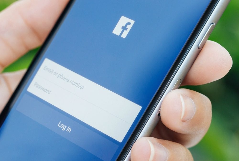 """phone with facebook login page"""